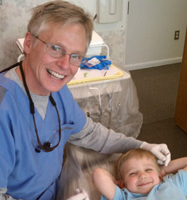 Dr. Efird with a smiling young patient
